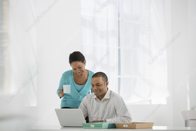 Man and woman in an office with laptop