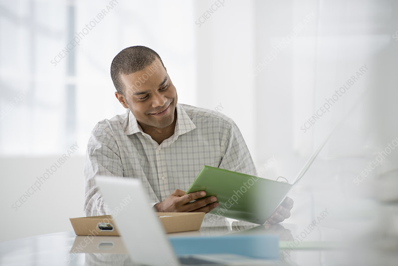 Businessman with paperwork and tablet