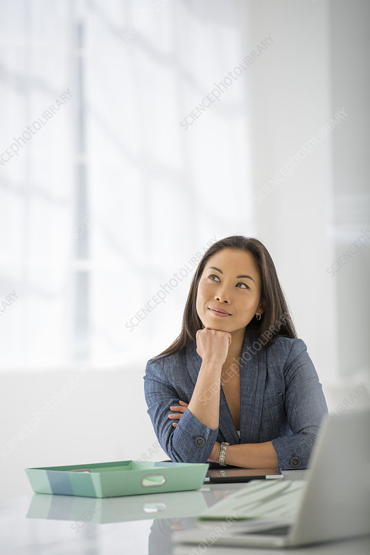 Businesswoman relaxing in an office