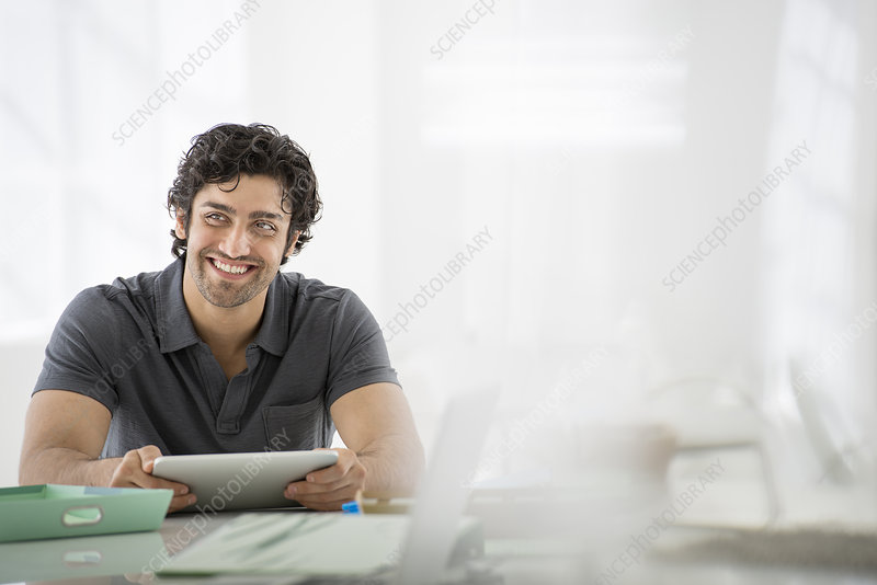 Man in an office with a digital tablet