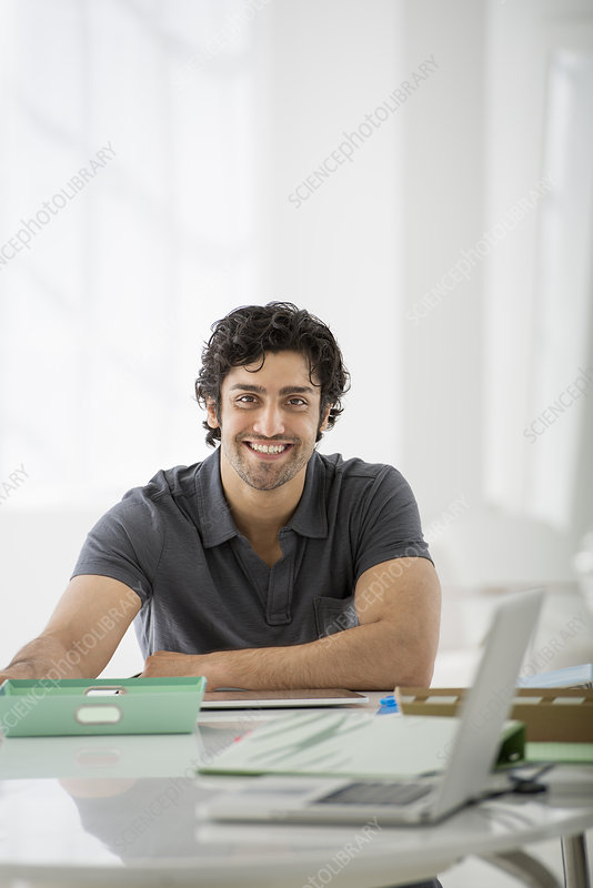 Businessman seated at a desk