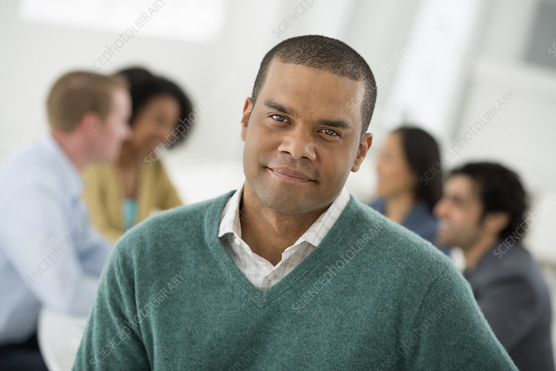 Man smiling confidently at Meeting
