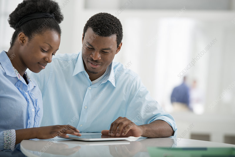 Man and woman sharing a digital tablet