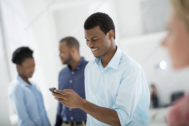 Man on a smart phone with Group