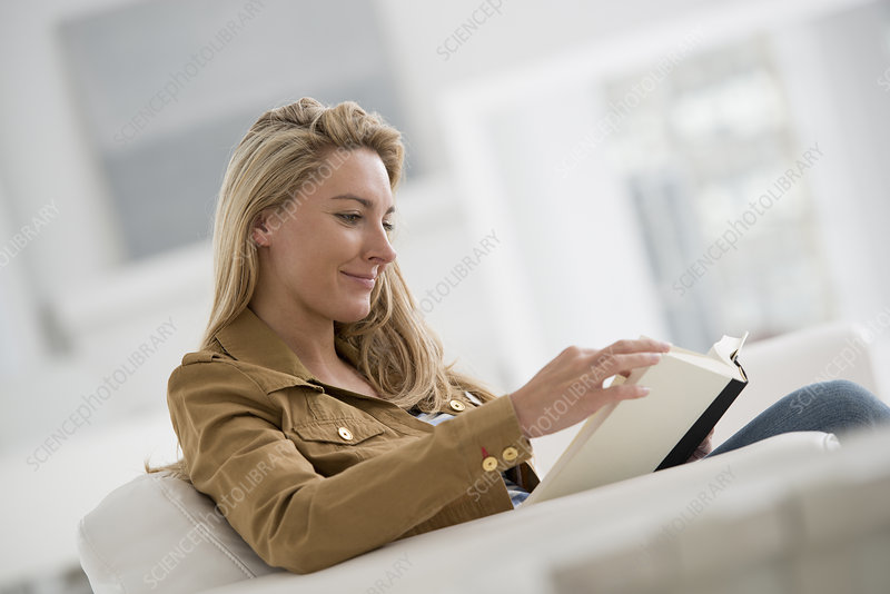 Woman seated reading book