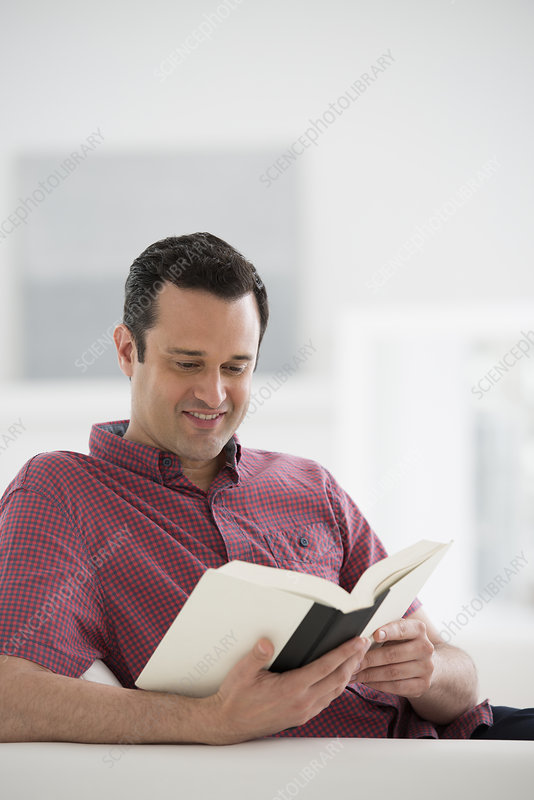 Man seated reading book