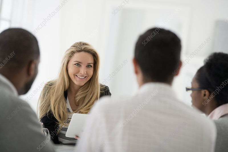 Four people at business meeting