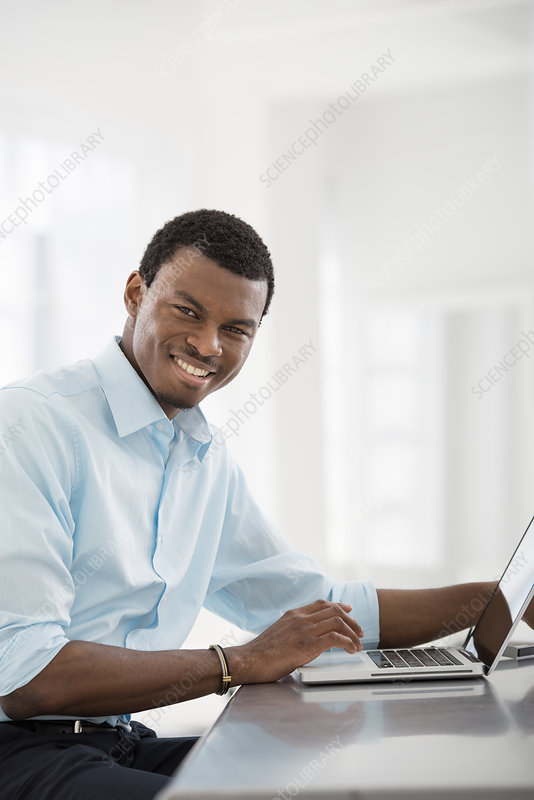 Man working on Laptop in an office