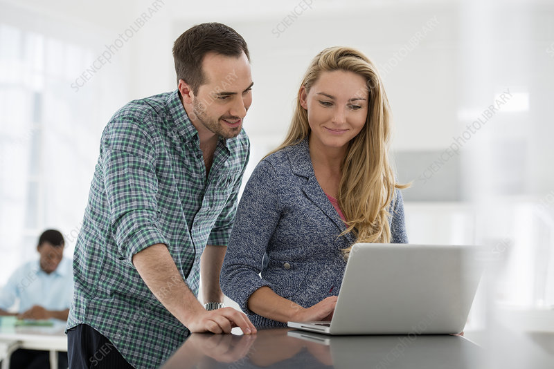 Two people working using computer