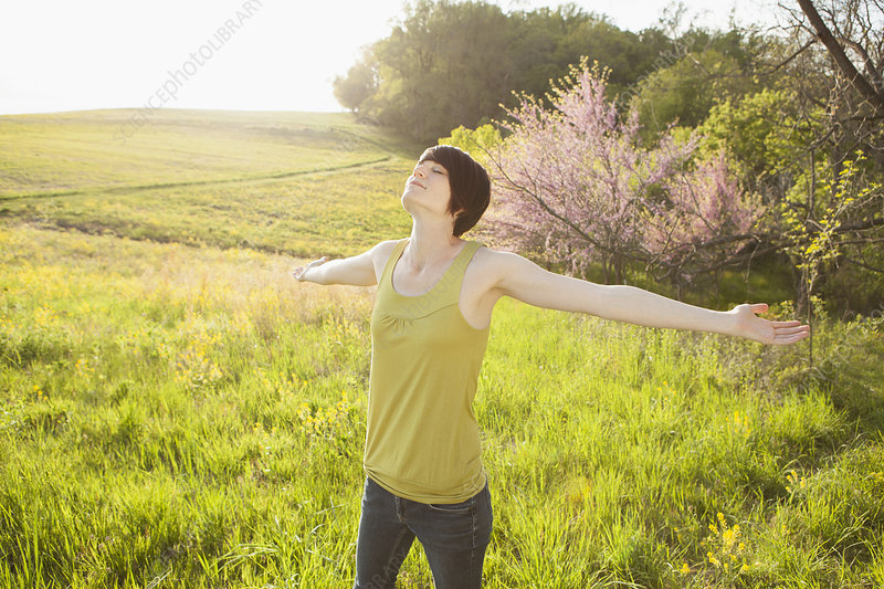Young woman outdoors in field