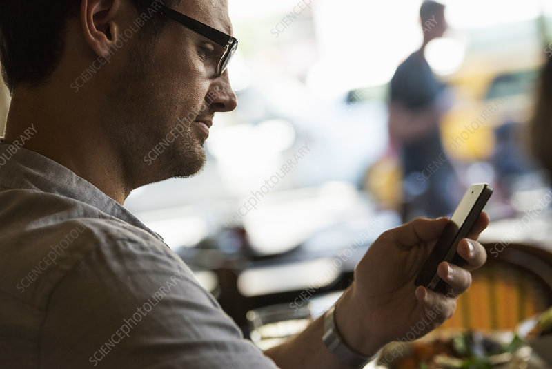 Man looking at his mobile phone
