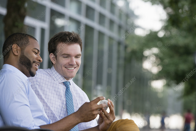 Summer Two men Sitting Using Smart phone