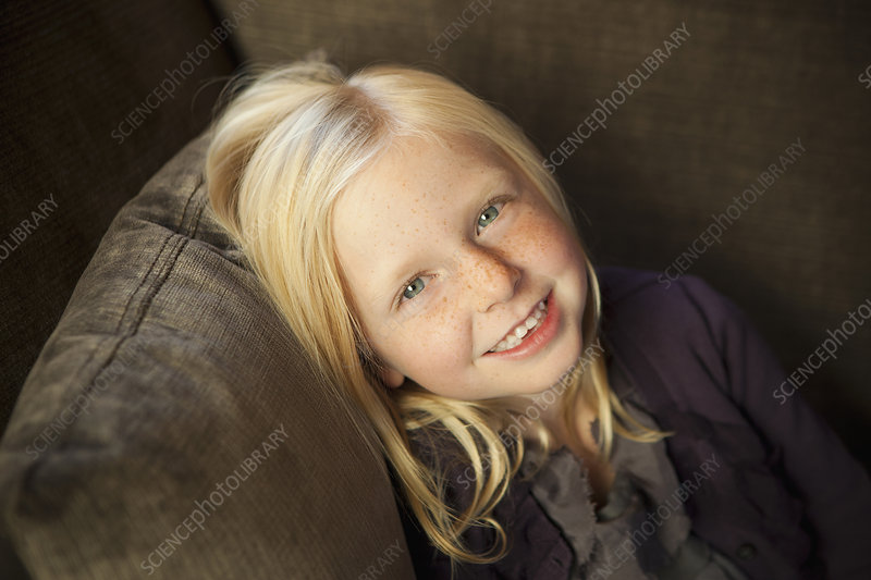Girl seated on couch