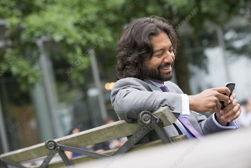 Businessman using his phone