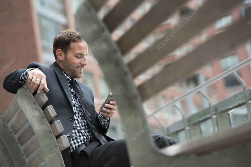Businessman in a suit on his phone