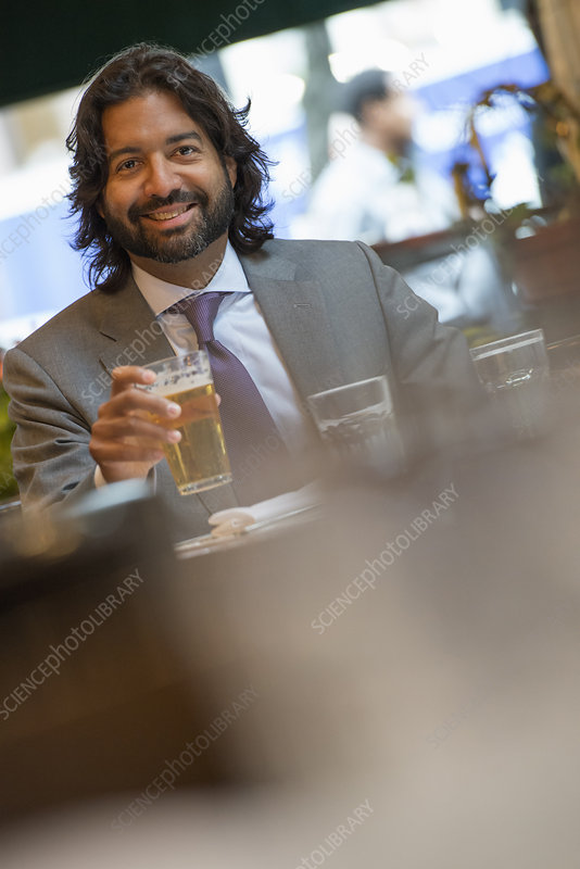 Businessman seated at cafe table
