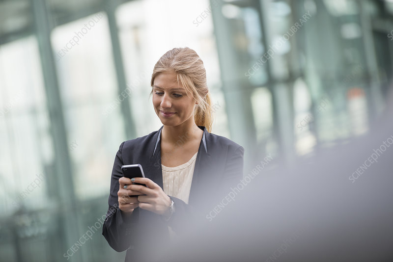 Blonde businesswoman Using Smart phone