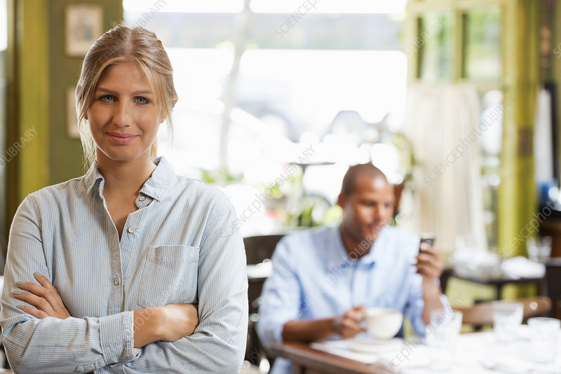 Coffee Shop couple checking smart phone