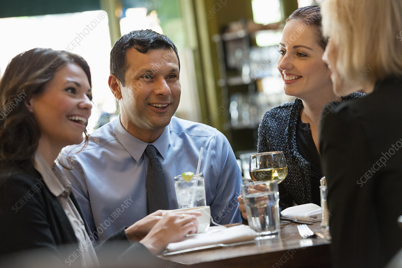 Four people sitting at cafe table