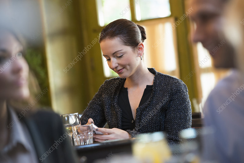 Three people seated at cafe table