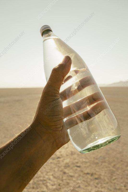 Bottle of water in the desert