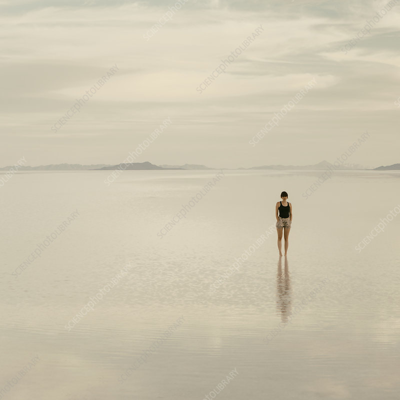Woman at dusk on Bonneville Salt flats
