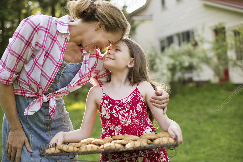 Girl holding tray of homemade cookies
