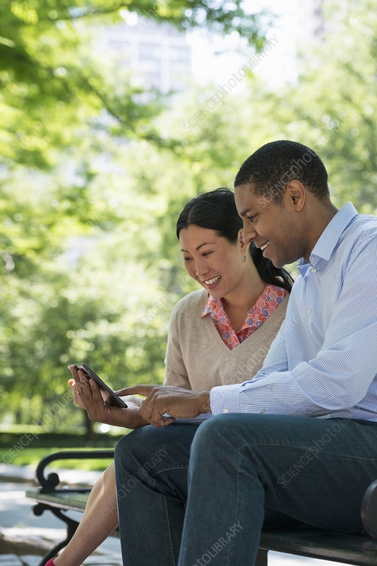 Man and woman looking at a digital tablet