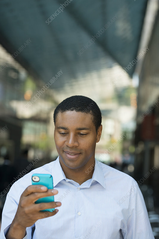 Man checking his phone for messages