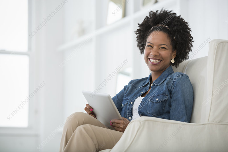 Woman seated using a digital tablet