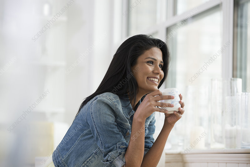 Woman holding White china coffee cup