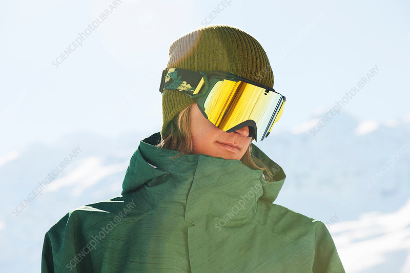 Portrait of a young male snowboarder