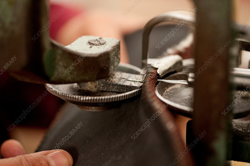 Person using machine to work leather