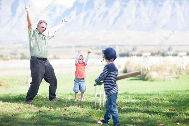Boys grandfather playing cricket