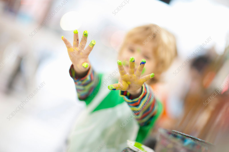 Boy with paint on his hands