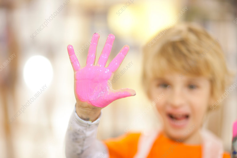 Boy with pink paint on his hand