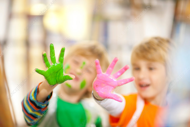 Boys with paint on their hands