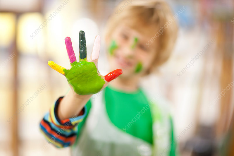 Boy with paint on his hand