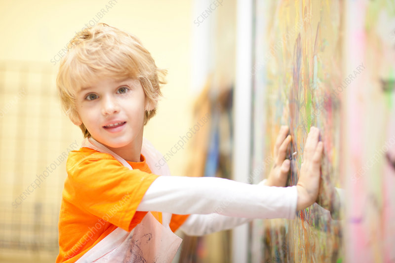 Boy touching painting