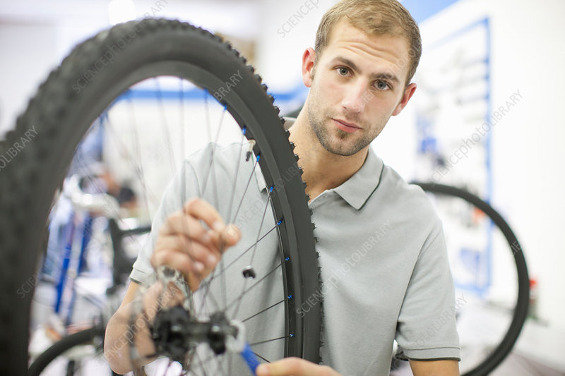 Young man working on bicycle