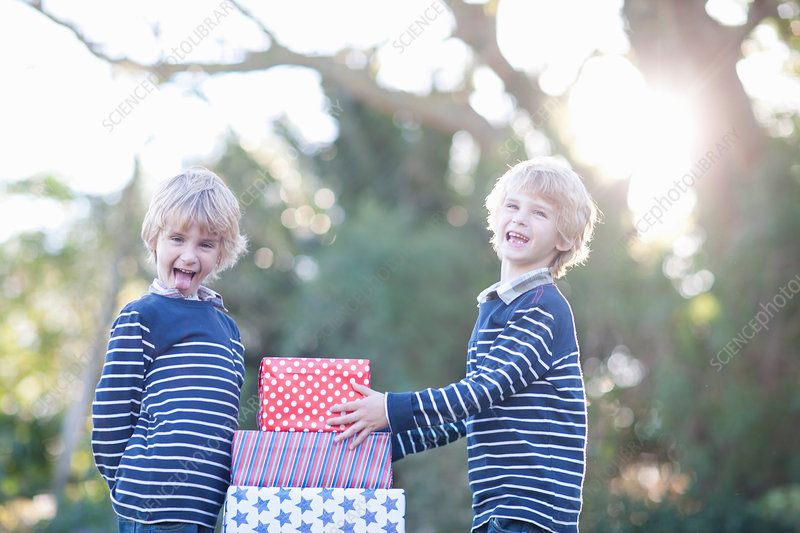Twin boys with birthday gifts