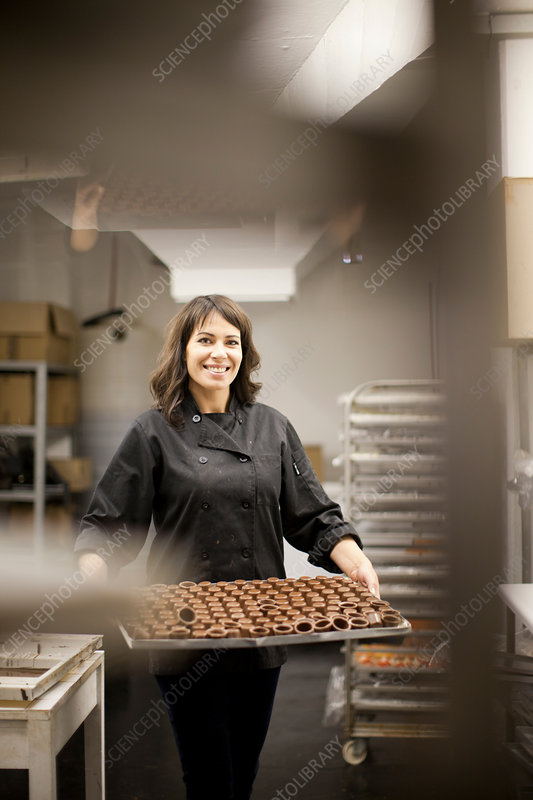 Woman holding tray with chocolate
