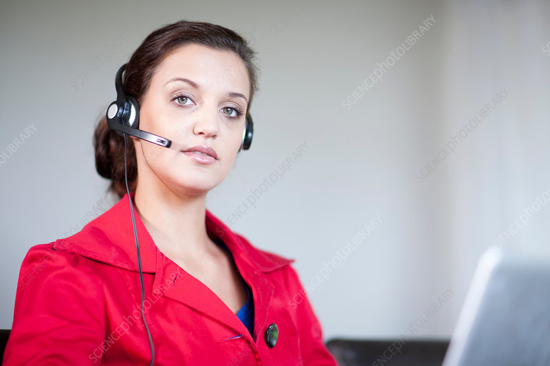 Young woman wearing telephone headset