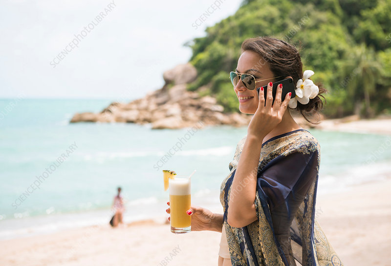 Woman using mobile phone, Thailand