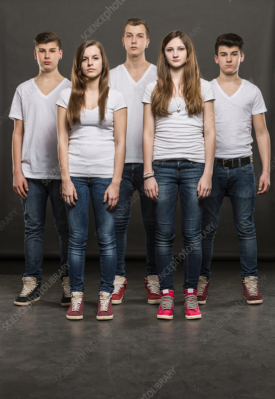 Five teenagers standing in a group