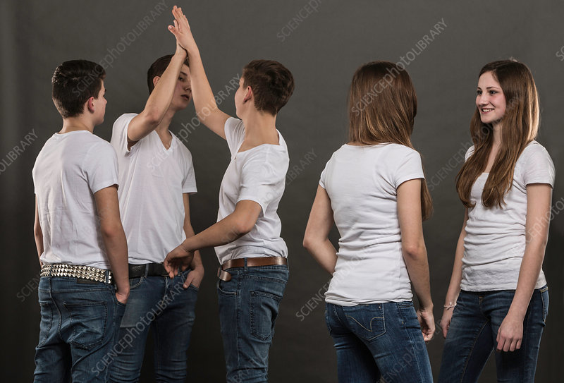 Five teenagers standing chatting