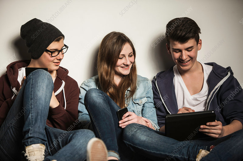 Teenagers using digital tablet
