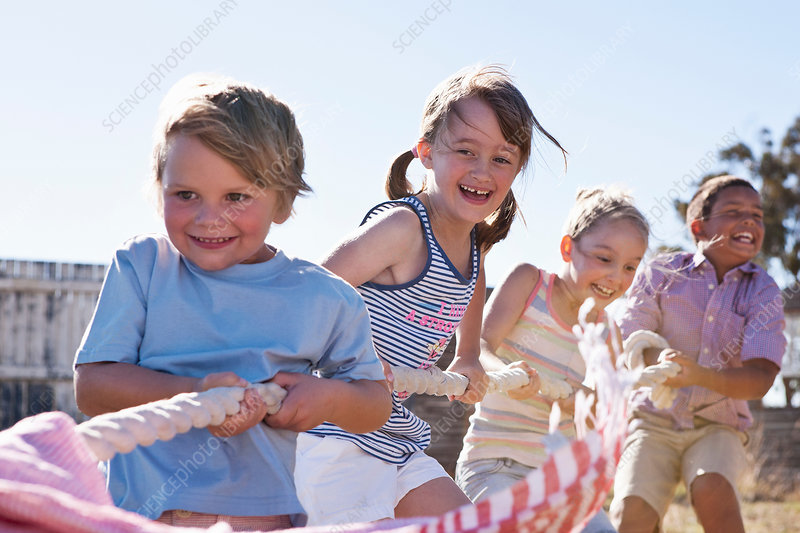 Four children playing tug of war