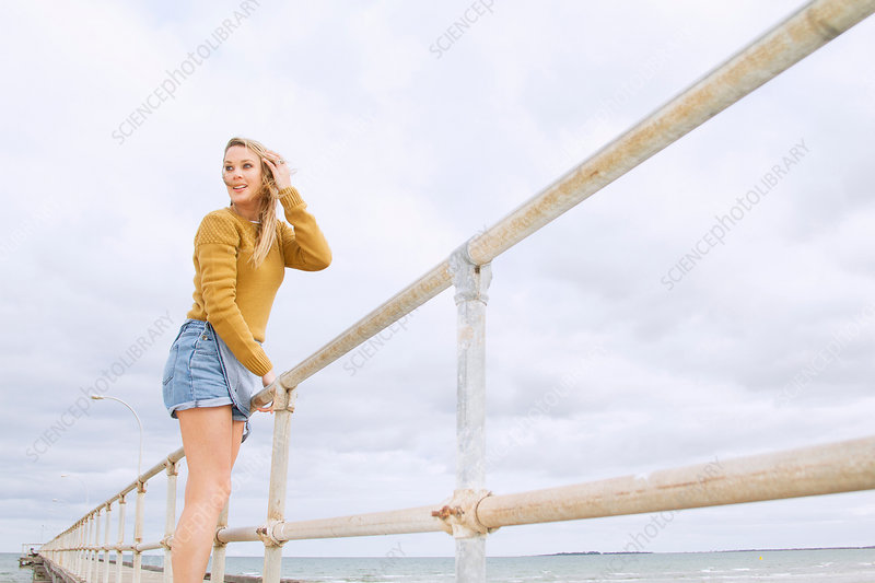 Young woman standing on pier