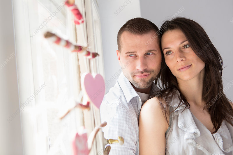 Mid adult couple sitting in window seat